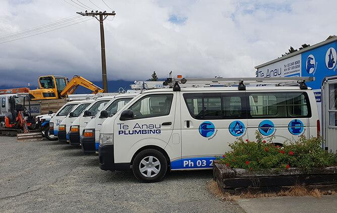 Te Anau Plumbing vehicles including vans and diggers