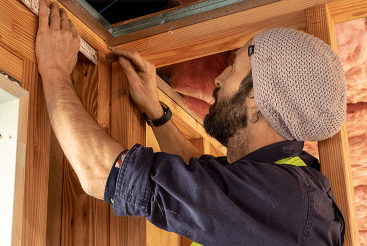 Te Anau plumber using a ruler on a new house plumbing installation